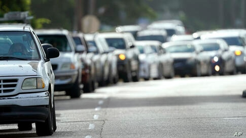 People wait in their vehicles in line at a COVID-19 testing site, Tuesday, July 14, 2020, in Houston. (AP Photo/David J…