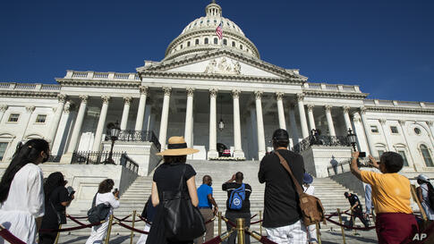 People pay their respects to the late Rep. John Lewis, D-Ga., lying in state on the East Front Steps of the U.S. Capitol,…