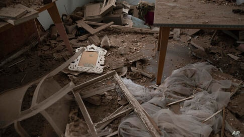 Debris lay inside a damaged apartment at a neighborhood near the scene of Tuesday's explosion that hit the seaport of Beirut,…