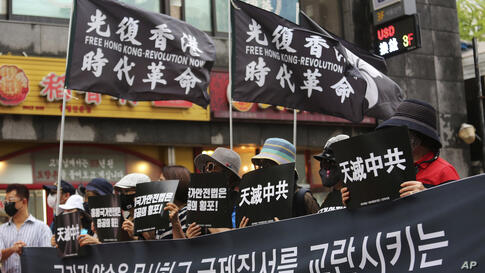 Protesters denounce the arrest of Hong Kong media tycoon Jimmy Lai during a rally against the National Security Law imposed in…