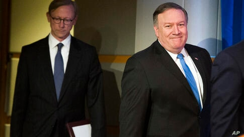Secretary of State Mike Pompeo, right, followed by Brian Hook, special representative for Iran, walk to a podium to announce…
