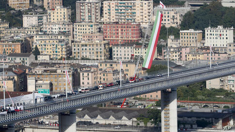 An Italian flag waves on the occasion of the inauguration of the new San Giorgio Bridge in Genoa, Italy, Monday, Aug. 3, 2020…