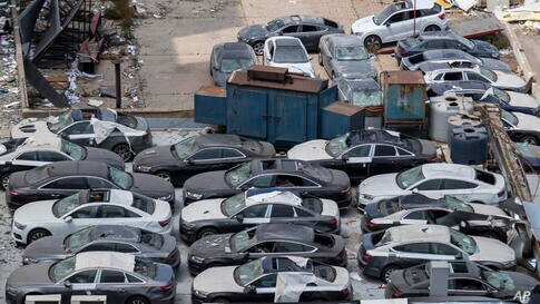 Damage brand new Audi cars are parked next to the Tuesday's explosion in the seaport of Beirut, Lebanon, Friday, Aug. 7, 2020…