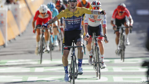 Slovenia's Primoz Roglic celebrates as he crosses the finish line to win the fourth stage of the Tour de France cycling race…