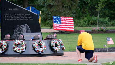 A man kneels at the Washingtonville Firefighters World Trade Center Memorial on the 19th anniversary of the 9/11 terror attacks…
