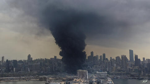 Black smoke rises from a fire at warehouses at the seaport of Beirut, Lebanon, Thursday, Sept. 10. 2020. A huge fire broke out…