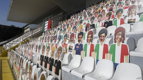 Selfies of Formula One spectators are displayed on the main stands, otherwise empty because of COVID-19 restrictions, at the…