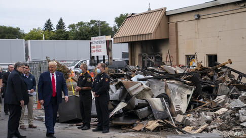 President Donald Trump tours an area on Tuesday, Sept. 1, 2020, damaged during demonstrations after a police officer shot Jacob…