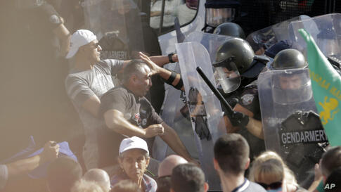 Police scuffle with protesters during rally in front of the new National Assembly building, demanding government resignation in…