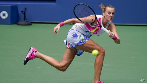 Petra Kvitova, of the Czech Republic, returns a shot to Kataryna Kozlova, of the Ukraine, during the second round of the US…