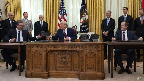 President Donald Trump participates in a signing ceremony with Serbian President Aleksandar Vucic, left, and Kosovar Prime…
