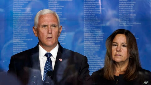 Vice President Mike Pence and his wife Karen, behind a protective barrier, attend a ceremony organized by the Tunnel to Towers…