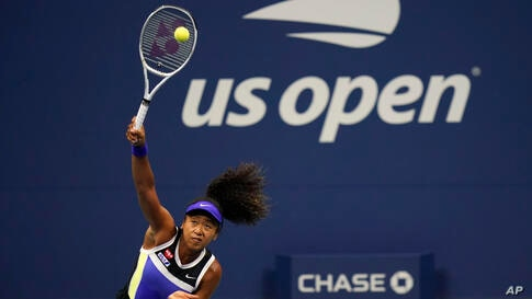 Naomi Osaka, of Japan, serves to Misaki Doi, of Japan, during the first round of the US Open tennis championships, Monday, Aug…