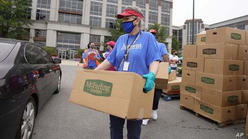 IMAGE DISTRIBUTED FOR ANTHEM - Anthem volunteers distribute food to the community from the company's headquarters in…