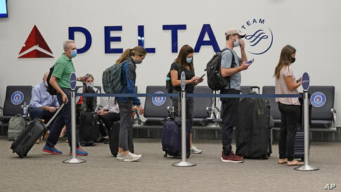 Delta passengers wait to board their flight in the new terminal at the Salt Lake City International Airport Tuesday, Sept. 15,…