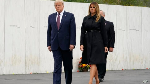 President Donald Trump and first lady Melania Trump arrive for a 19th anniversary observance of the Sept. 11 terror attacks, at…