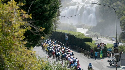 The pack of cyclists ride past the Marmore Waterfalls during the fourth stage of the Tirreno Adriatico cycling race, from Terni…