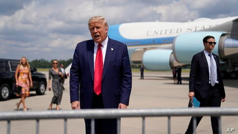President Donald Trump speaks to a crowd as he arrives at Wilmington International Airport, Wednesday, Sept. 2, 2020, in…