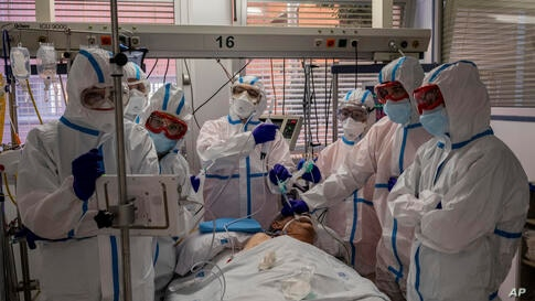 A patient infected with COVID-19 is treated in one of the intensive care units (ICU) at the Severo Ochoa hospital in Leganes,…