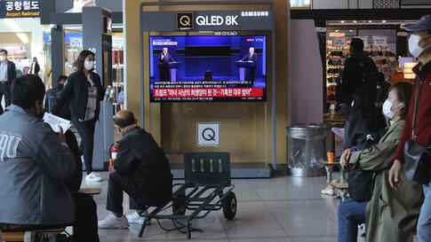 A TV screen shows a live broadcast of U.S. President Donald Trump, left, and Democratic presidential candidate former Vice…