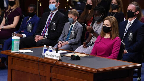 Supreme Court nominee Amy Coney Barrett listens during her Senate Judiciary Committee confirmation hearing on Capitol Hill in…