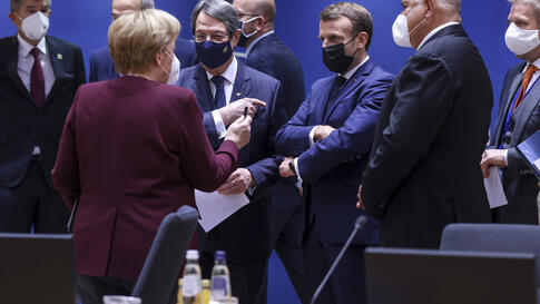 German Chancellor Angela Merkel, center left, speaks with French President Emmanuel Macron, center right, and Cypriot President…