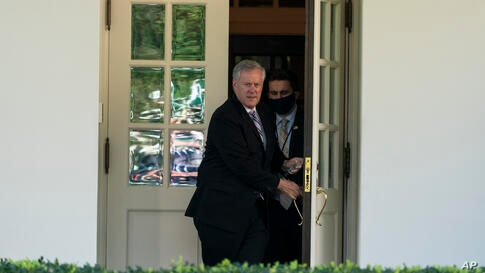 White House Chief of Staff Mark Meadows steps out of the West Wing to speak with reporters at the White House, Friday, Oct. 2,…