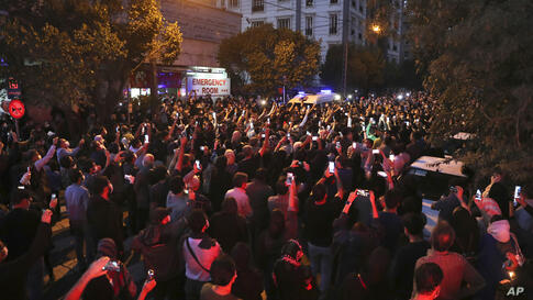 Fans gather outside the Jam Hospital where the nation's famous singer Mohammad Reza Shajarian has died of cancer at the age of…