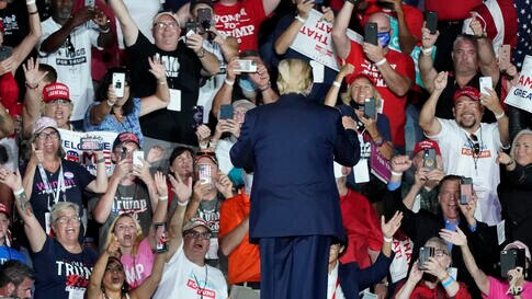 Supporters cheer as President Donald Trump leaves a campaign rally at the Orlando Sanford International Airport Monday, Oct. 12…