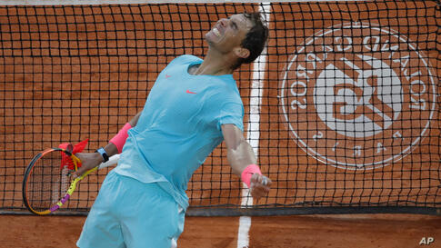 Spain's Rafael Nadal celebrates winning the semifinal match of the French Open tennis tournament against Argentina's Diego…