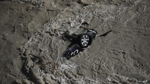 A car was swept away during floods in the Roya river of Breil-sur-Roya, near the border with Italy, Monday, Oct.5, 2020…