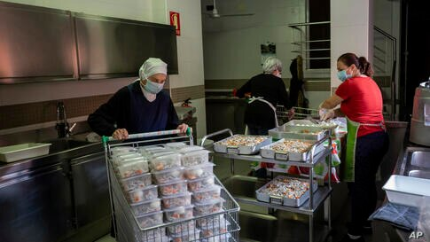 Volunteers and members of the Catholic Servants of Jesus congregation prepare food donations in Madrid, Spain, Thursday, Oct. 8…