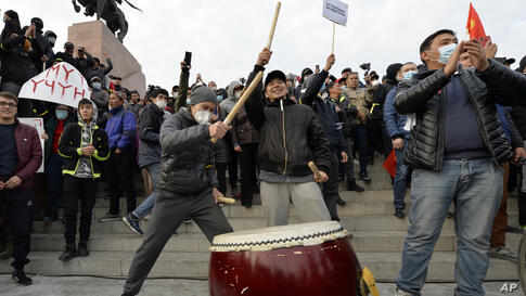Supporters of former President Almazbek Atambayev bang on the drum during a rally on the central square in Bishkek, Kyrgyzstan,…