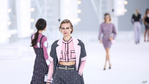 Models wear creations for the Chanel Spring-Summer 2021 fashion collection, Tuesday, Oct. 6, 2020, during Paris fashion week. …