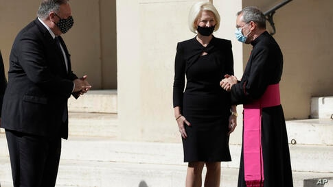 U.S. Secretary of State Mike Pompeo, left, and U.S. Ambassador to the Holy See Callista L. Gingrich greet Monsignor Joseph…