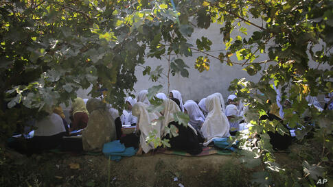 Afghan students attend an open air class at a primary school in Kabul, Afghanistan, Wednesday, Oct. 7, 2020. The World Bank…