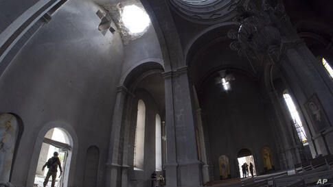 A hole made by shell in the roof of the Holy Savior Cathedral during a military conflict, in Shushi, outside Stepanakert, self…