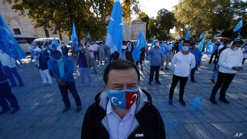 Protesters from the Uighur community living in Turkey, carry flags of what ethnic Uighurs call 'East Turkestan', during a…