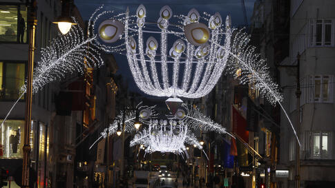 Christmas lights light up the streets of Mayfair during a second lockdown in London, Thursday, Nov. 19, 2020. Businesses that…