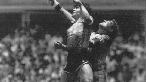 FILE - In this June 22, 1986 file photo  Argentina's Diego Maradona, left, beats England goalkeeper Peter Shilton to a high…