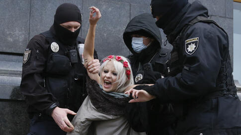 "Police detain an activist from Ukrainian female rights organization ""Femen"" on the International Day for the Elimination of…"