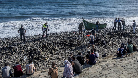 Migrants, most of them from Morocco, are watched by Spanish Police after arriving at the coast of the Canary Islands, Spain on…