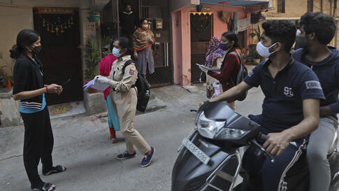 Health workers conduct a door to door survey to assess the COVID-19 situation in New Delhi, India, Monday, Nov. 23, 2020. India…