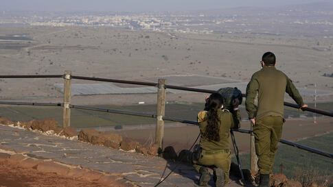 Israeli soldiers observe Al Qunaitra, Syria, across the border from Mount Bental in the Israeli-controlled Golan Heights,…