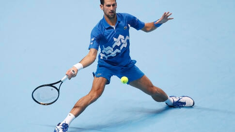 Novak Djokovic of Serbia plays a return to Diego Schwartzman of Argentina during their singles tennis match at the ATP World…