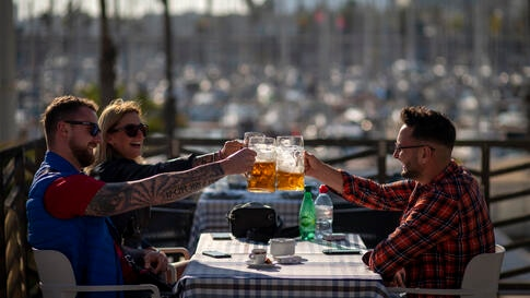 Tourists toast on a bar terrace just reopened to customers in Barcelona, Spain, Monday, Nov. 23, 2020. Restaurants and bars in…