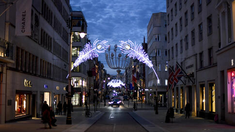 Christmas lights are lit up on New Bond Street in Mayfair, London, Tuesday, Nov. 24, 2020. Haircuts, shopping trips and visits…