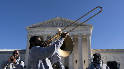 """The """"Too Much Talent,"""" band performs in front of the U.S. Supreme Court as arguments are heard about the Affordable Care Act,…"""