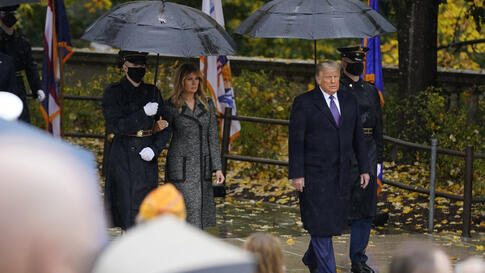 President Donald Trump and first lady Melania Trump arrive to participate in a Veterans Day wreath laying ceremony at the Tomb…