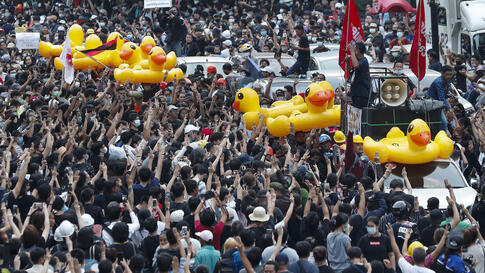 Large inflatable ducks are passed around the crowd at a pro-democracy rally in Bangkok, Thailand, Wednesday, Nov. 18, 2020…